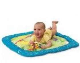 Сучасні іграшки для малюка до року фото
